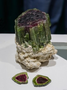 Watermelon tourmaline rough crystal with two slices, from Brazil.